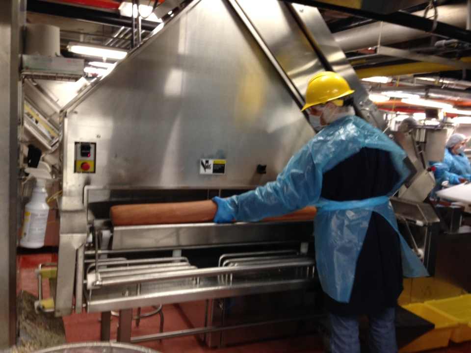 A chub of bologna is loaded into a slicing machine at the Schneiders plant in Kitchener on Thursday, Feb. 26, 2015. (David Imrie / CTV Kitchener)