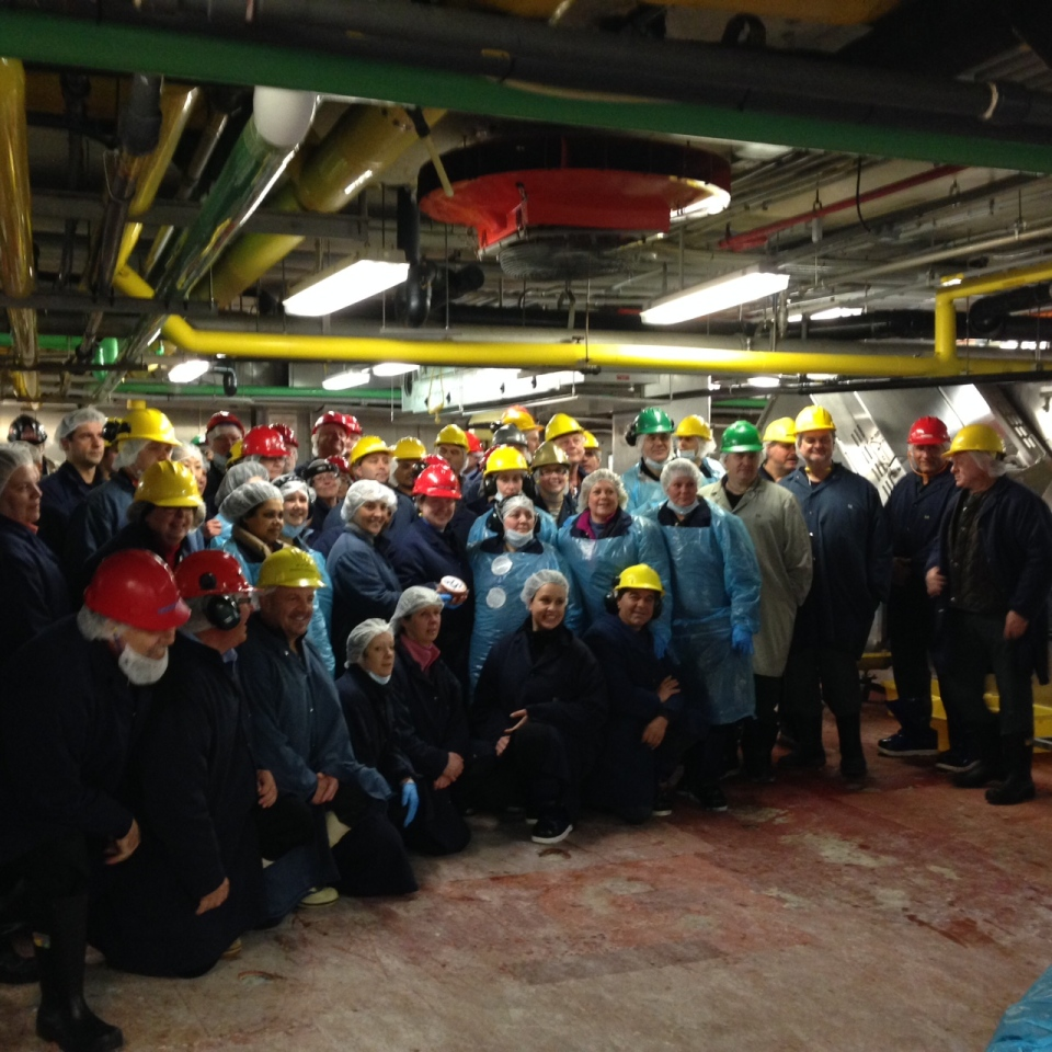 The final employees of the Schneiders plant in Kitchener pose for a photograph after production ends on Thursday, Feb. 26, 2015. (David Imrie / CTV Kitchener)