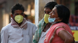 Indians cover their faces as a preventive measure against swine flu in Hyderabad, on Friday, Feb. 20, 2015. (AP/Mahesh Kumar A.)