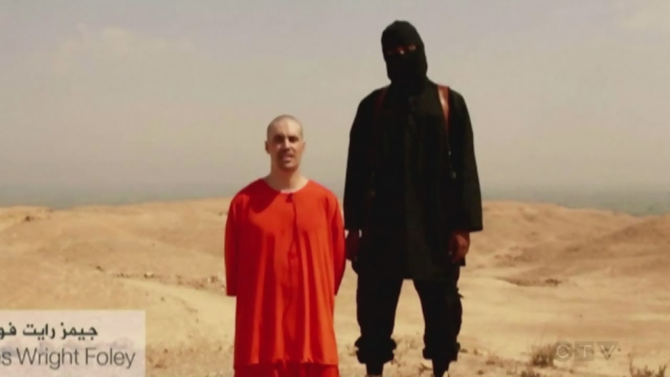 Mohammed Emwazi, the man suspected of being 'Jihadi John,' is seen in this undated still image taken from video standing beside journalist James Foley.