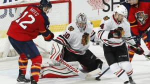 Chicago Blackhawks goaltender Corey Crawford stops a shot by Florida Panthers forward Jimmy Hayes during the third period of an NHL hockey game on Feb. 26, 2015, in Sunrise, Fla. (AP / Joel Auerbach)