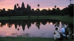 Tourists check out the stunning view of the Angkor Wat temples outside Siem Reap, Cambodia, with the ruins silhouetted by a sunrise on July 14, 2004. (AP / Anat Givon)