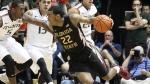 Florida State University NCAA college basketball player Xavier Rathan-Mayes with the ball, on  Feb. 25, 2015. (AP / El Nuevo Herald, Hector Gabino)