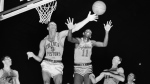 Earl Lloyd (11) reaches for the ball during an April, 1955, NBA basketball game in Indianapolis.  (AP / File)