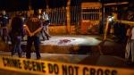 Bangladeshi policemen investigate the site of the attack on Avijit Roy, in Dhaka, on Feb. 26, 2015. (AP / Rajib Dhar)