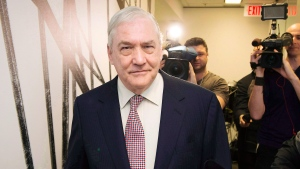 Conrad Black walks past reporters while arriving for his hearing at the Ontario Securities Commission in Toronto on Friday, Oct. 10, 2014. (Darren Calabrese / THE CANADIAN PRESS)
