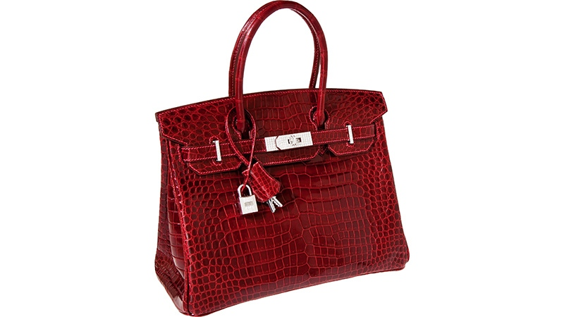 This photo provided by Heritage Auctions shows a red crocodile Hermes Diamond Birkin handbag that sold for $203,150 in 2011. (AP / Heritage Auctions)
