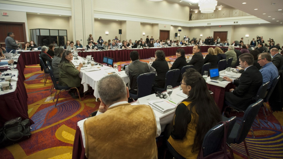 Aboriginal leaders, government officials, and family members of missing and murdered women wait for the start of the National Roundtable on Missing and Murdered Indigenous Women and Girls in Ottawa on Friday, Feb. 27, 2015. (Justin Tang / THE CANADIAN PRESS)
