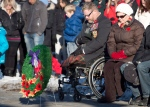Veteran Paul Franklin, who lost both his legs in a suicide bombing in Kandahar, takes part in a moment of silence during the First Battalion Princess Patricia's Canadian Light Infantry Remembrance Day ceremony in Edmonton, Alberta on Monday November 11, 2013. (THE CANADIAN PRESS / Jason Franson)