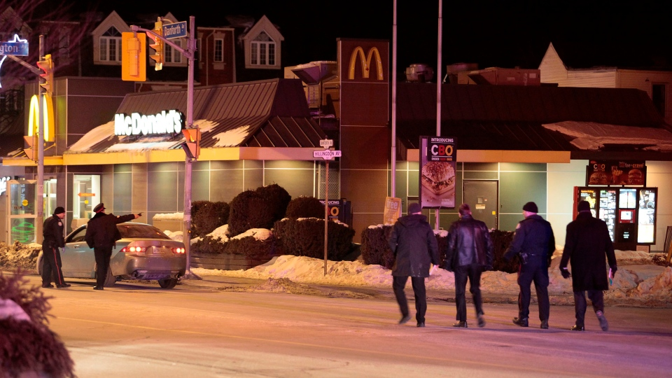 Police attend the scene of a shooting at a McDonald's restaurant near Danforth and Coxwell avenues Saturday February 28, 2015. (John Hanley / CP24)