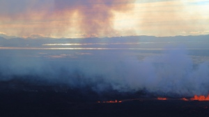 In this aerial view, smoke and lava rise from a fissure in the ground on the north side of the Bardarbunga volcano in Iceland, Tuesday, Sept. 2, 2014. (AP /Stefano Di Nicolo)
