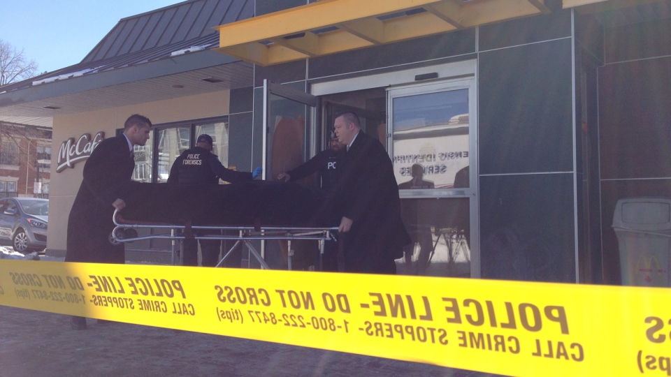 Officers remove a body from a McDonald's restaurant in Toronto, Feb. 28, 2015. (Scott Lightfoot / CTV Toronto)