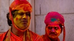Indian villagers from Nandgaon wait for the arrival of villagers from Barsana at the Nandagram temple, famous for Lord Krishna and his brother Balram, during Lathmar holi festival, in Nandgaon, India, Saturday, Feb. 28, 2015. (AP / Saurabh Das)