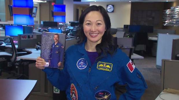 Dr. Julielynn Wong poses in astronaut Chris Hadfield's flight suit.