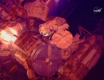 In this image from NASA television astronaut Terry Virts exits the Quest airlock hatch beginning the third spacewalk outside the International Space Station early Sunday morning March 1, 2015. (AP /NASA-TV)