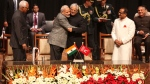 Indian Prime Minister Narendra Modi, center left, greets Peoples Democratic Party Mufti Mohammed Sayeed after the later was sworn in as the chief minister of Jammu and Kashmir state in Jammu, India, Sunday, March 1, 2015. (AP / Channi Anand)