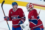 Montreal Canadiens goalie Carey Price is congratulated by teammate Brendan Gallagher after shutting out the Toronto Maple Leafs 4-0 in NHL hockey action Saturday, February 28, 2015 in Montreal. (Paul Chiasson/THE CANADIAN PRESS)