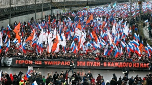 People carry a huge banner reading 'those bullets for everyone of us, heroes never die!' as they march in memory of opposition leader Boris Nemtsov who was gunned down on Friday, Feb. 27, 2015 near the Kremlin, in Moscow, Russia, Sunday, March 1, 2015. (AP / Dmitry Lovetsky)