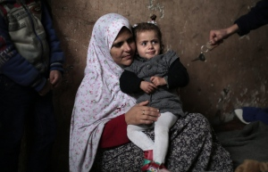 Palestinian mother Abeer, 36, holds her daughter, Anwar Saad, at their family home in Gaza City on Tuesday, Jan. 27, 2015. (AP / Khalil Hamra)