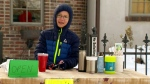 Kid selling hot chocolate for a good cause