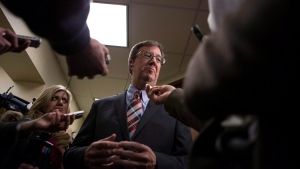 Ottawa Mayor Jim Watson scrums with the press as he attends the Big Cities summit hosted by the Federation of Canadian Municipalities in Toronto on Thursday February 5 2015 .(The Canadian Press / Chris Young)