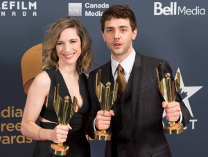 Nancy Grant and Xavier Dolan pose backstage with their awards at the Canadian Screen Awards in Toronto on Sunday, March 1, 2015. (Frank Gunn / THE CANADIAN PRESS)