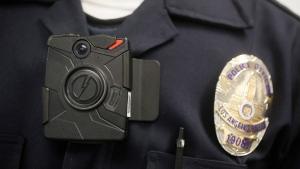 A Los Angeles Police officer wears an on-body cameras during a demonstration for media in Los Angeles on Jan. 15, 2014. (AP / Damian Dovarganes)