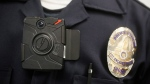 A Los Angeles Police officer wears an on-body camera on Jan. 15, 2014. (Damian Dovarganes / AP)