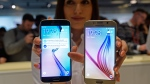 The new Galaxy S6, right, and S6 Edge at the Mobile World Congress in Barcelona, Spain, on March 1, 2015. (AP / Manu Fernandez)