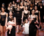 Model Bianca Balta won applause of approval as she walked down the Dolce&Gabbana runway in an advanced stage of pregnancy. It was part of the designing duo's early Mother's Day present to women, a collection dedicated to moms.