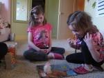 Alexis Carey, left, 10, plays with her sister Alanis Carey, right, 5 on Friday, Feb. 27, 2015 in Boise, Idaho. (AP Photo/Kimberlee Kruesi)