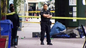 A member of the Los Angeles police department stands near the scene where a homeless man was shot and killed after an altercation with police on March 1, 2015.