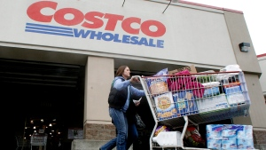 A shopper leaves a Costco store in Portland, Ore., on Dec. 7, 2011. (AP / Rick Bowmer)