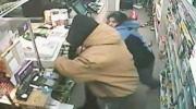 Store clerk fights off gun wielding robber