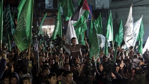 Palestinian Hamas supporters hold Hamas green flags as they protest an Egyptian court ruling that declared the territory's ruling Hamas a terrorist organization, in Gaza City, Sunday, March 1, 2015. (Khalil Hamra/AP)