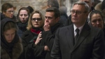 Opposition leaders, former Russian Prime Minister Mikhail Kasyanov, right, and Ilya Yashin, centre, together with other relatives and friends pay their last respects by the coffin of Boris Nemtsov, a charismatic Russian opposition leader and sharp critic of President Vladimir Putin, during a farewell ceremony inside the Sakhavov's centre in Moscow, Russia on March 3, 2015. (AP / Pavel Golovkin)