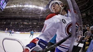 Montreal Canadiens' Jeff Petry is pressed against the boards on March 2, 2015. (AP / Marcio Jose Sanchez)