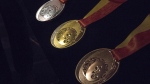 Toronto 2015 Pan Am Games silver, gold and bronze medals are displayed as the organizing committee unveils the medals that will be awarded at the games during an announcement in Toronto on Tuesday, March 3, 2015. (Chris Young / THE CANADIAN PRESS)