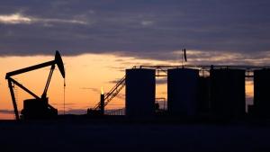 Pump jack & oil storage tanks near Williston, N.D.