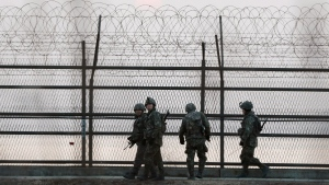 South Korean soldiers patrol along a barbed-wire fence near the demilitarized zone with North Korea, on Monday, March 2, 2015. (AP/Ahn Young-joon)