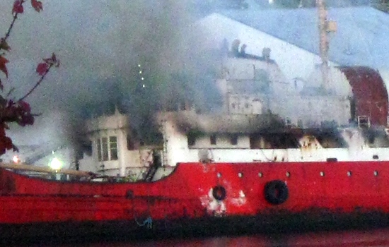 An old Canadian Coast Guard vessel burns in Dartmouth, N.S. early Saturday, Oct. 11, 2008. (Crystal Anketell / MyNews.CTV.ca)