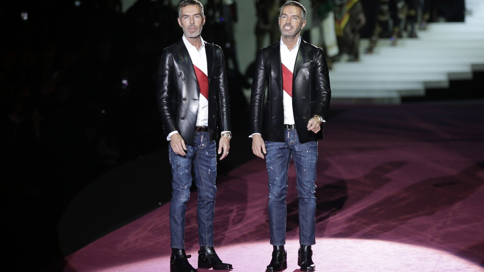 Canadian fashion designers Dean Caten, right, and Dan Caten acknowledge the applause of the audience after presenting their DSquared2 women's Fall-Winter 2015-2016 collection, part of the Milan Fashion Week, unveiled in Milan, Italy, Monday, March 2, 2015. (AP / Antonio Calanni)