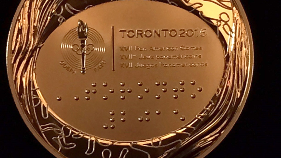 A Toronto 2015 Pan Am Games medal is shown in Toronto on Tuesday, March 3, 2015. (Lori Ewing / THE CANADIAN PRESS)