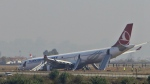 A Turkish Airlines jet is seen after it skidded off a slippery runway while landing in dense fog at Tribhuwan International Airport in Kathmandu, Nepal on March 4, 2015. (AP / Niranjan Shreshta)
