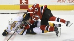 Nashville Predators' Shea Weber pulls down New Jersey Devils' Steve Bernier during the third period of an NHL hockey game on March 3, 2015, in Newark, N.J. (AP / Bill Kostroun)