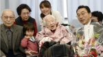 Japan's Misao Okawa, 116, centre, who is recognized as the world's oldest living person by Guinness World Records, poses with her relatives and Ward Mayor Takehiro Ogura, right, as she is celebrated at a nursing home in Osaka, western Japan on March 4, 2015 ahead of her birthday. (Kyodo News)