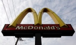 In this Friday, Oct. 4, 2013, photo, a McDonald's restaurant sign is seen at a McDonald's restaurant in Chicago. The company reports quarterly earnings on Monday, Oct. 21, 2013. (AP Photo/Nam Y. Huh)