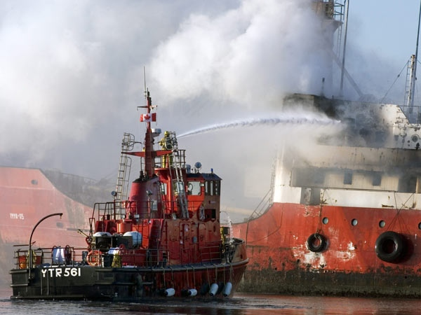 The Canadian Navy fireboat, YTR 561 Firebird, battles a blaze aboard MV Caruso, a former coast guard ship, moored at Dartmouth's marine slips in Dartmouth, N.S. on Saturday, Oct.11, 2008. (THE CANADIAN PRESS / Andrew Vaughan)