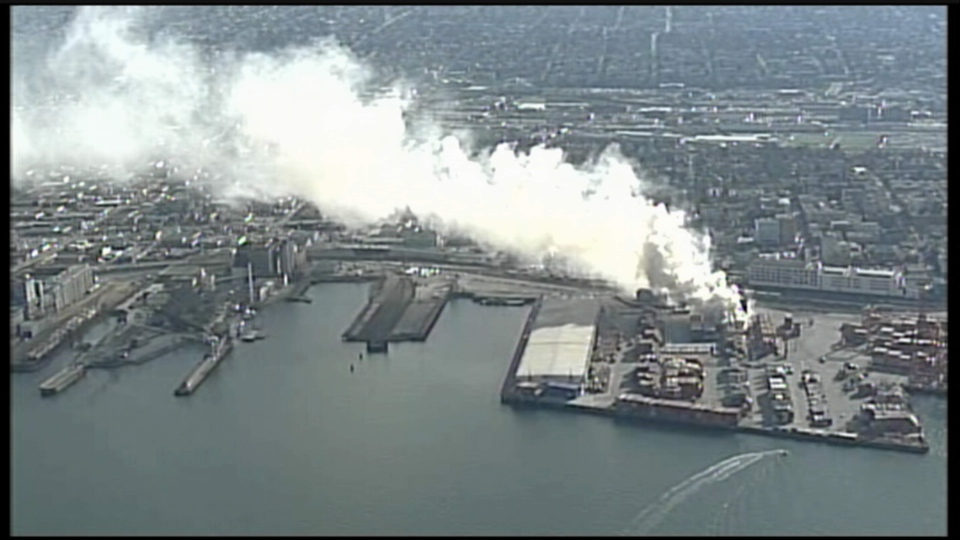 Large plumes of smoke are seen billowing from the scene of a shipping container fire at the Port of Metro Vancouver, Wed., March 4, 2015. (CTV's Chopper 9)