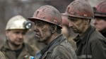 Ukrainian coal miners wait for a bus after returning to the surface of the Zasyadko mine in Donetsk, Ukraine on March 4, 2015. (AP / Vadim Ghirda)